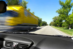 Blurred on the speed of the movement of trucks on the road Stock Images