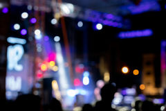 Blurred stage spot lights with smoke on night rock concert. Blurred stage spot lights with smoke on night time rock concert Royalty Free Stock Images