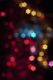 Blurred star-shape colored lights Stock Image