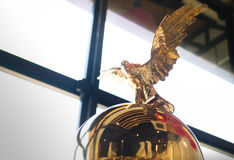 Blurred statue of a golden eagle Stock Image