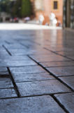 Blurred stone paved floor from low angle perspective. Stone paved floor from low angle perspective Royalty Free Stock Images
