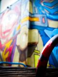 Blurred Street Art Wall Mural of a Robotic Face Stock Image