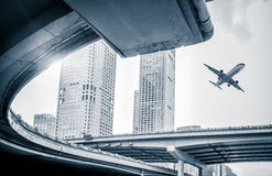 Blurred street scene in city with a plane flying over in city of China Stock Photography