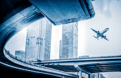 Blurred street scene in city with a plane flying over in city of China Royalty Free Stock Photography