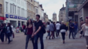 Blurred street scene with crowds of shoppers stock footage