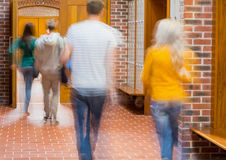 Blurred students walking through corridor Stock Photos