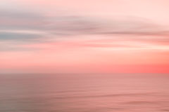 Blurred sunset sky and ocean Stock Photography