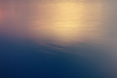 Blurred sunset sunrise on water mirroring Useful as background Stock Photos