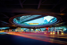 Blurred Tail Lights And Traffic Light on the cityscape. In thailand royalty free stock photo