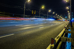 Blurred tail lights and traffic lights on road Royalty Free Stock Images
