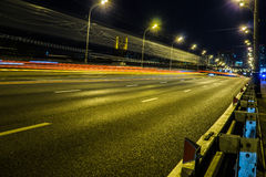 Blurred tail lights and traffic lights on road Stock Photos