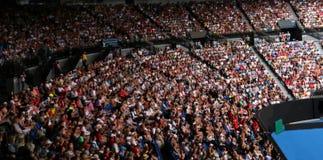 blurred tennis fans watch a tennis match stock photos
