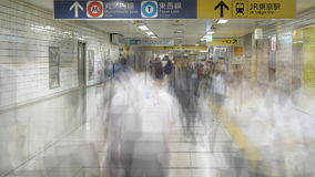 Blurred Time Lapse of  Commuters at Busy Tokyo Metrorail System stock video footage