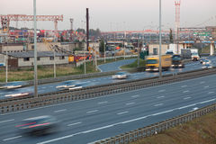 Blurred tracks of vehicles driving on four-lane highway, evening Royalty Free Stock Photos
