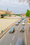 Blurred traffic car on a road of the Seine in Paris Royalty Free Stock Image