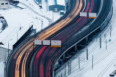 Blurred traffic on wintry road. Aerial view of colorful blurred lights of traffic in motion on road through snow covered city of Moscow, Russian Federation Stock Photo