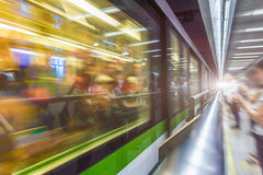 Blurred train at night leaving station Stock Photos