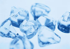 Blurred transparent glassy ice closeup Stock Images