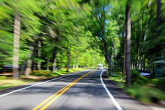 Blurred Trees Along Highway Royalty Free Stock Photography
