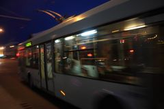 Blurred trolley on the street. Movement of the trolley along the street at dusk with motion blur stock photography