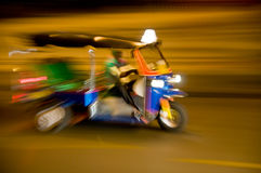 Blurred tuk-tuk taxi in Bangkok, Thailand Royalty Free Stock Images