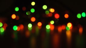 Blurred unfocused background with lights. At black background that change color stock video footage