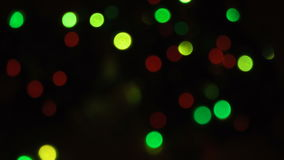 Blurred unfocused background with lights. Blurred unfocused background with bright lights at black background stock footage