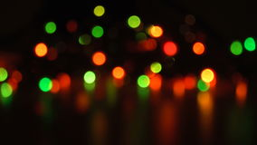 Blurred unfocused background with lights. Bright blurred unfocused background with lights at black background stock footage