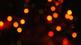 Blurred unfocused background with lights. Blurred unfocused background with Christmas lights at black background stock video footage