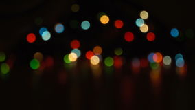 Blurred unfocused background with lights. Blurred unfocused background with color lights at black background stock video footage