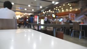 Blurred unrecognizable people walking in airport. Passengers going in waiting hall. Defocus background from busy big. Airport with people stepping for the stock footage