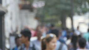 Blurred unrecognizable people are walking around city center. Out of focus is backdrop of bustling big indian city with. Busy traffic stock video