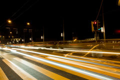 Blurred vehicle headlights on the road Royalty Free Stock Photography