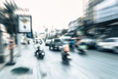 Blurred vehicle and motorcycle moving on the road in town Royalty Free Stock Image