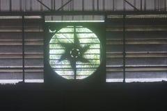 Blurred ventilator in factory. Blurred running of old ventilator in factory Royalty Free Stock Image