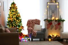 Blurred view of living room decorated for Christmas. Blurred view of beautiful living room decorated for Christmas Royalty Free Stock Photography