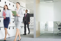 Blurred view of businesswomen walking in office Royalty Free Stock Image