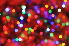 Blurred view of glowing Christmas lights on color background royalty free stock images