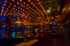 Blurred view of the interior of the bar in the evening for pattern and background Stock Photography