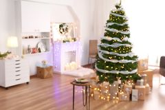 Blurred view of living room interior with beautiful Christmas. Tree Royalty Free Stock Photos