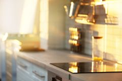 Blurred view of modern kitchen interior. With soft sunlight royalty free stock photo