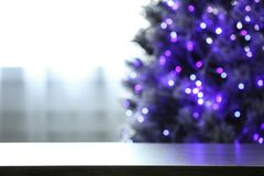 Free Blurred View Of Beautiful Christmas Tree With Purple Lights Near Window Indoors, Focus On Table. Royalty Free Stock Photo - 158976145