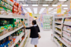 Blurred view of people in supermarket royalty free stock photography