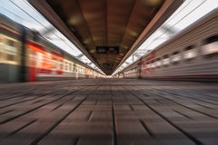 Blurred view of railway station with trains Royalty Free Stock Image
