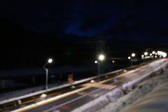 Blurred view of road with snow on sides. At night stock photography