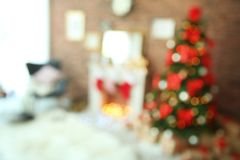 Blurred view of room with beautiful tree. Blurred view of room with beautiful Christmas tree royalty free stock photos