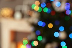 Blurred view of room interior with decorated tree. Blurred view of room interior with decorated Christmas tree stock photography