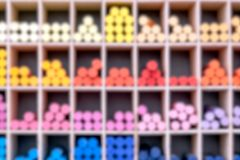 Blurred view of shop counter with colorful crayons for drawing.Blured circles. Colorful background. Blured background royalty free stock photo
