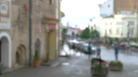 Blurred view of a street. People moving in the background. Interesting places to visit. Life of small town stock footage
