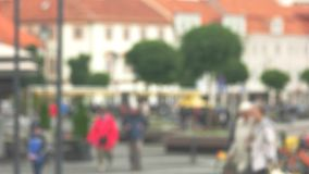 Blurred view of street. People walking in the background. Close to city bustle. Rhythm of modern life stock video